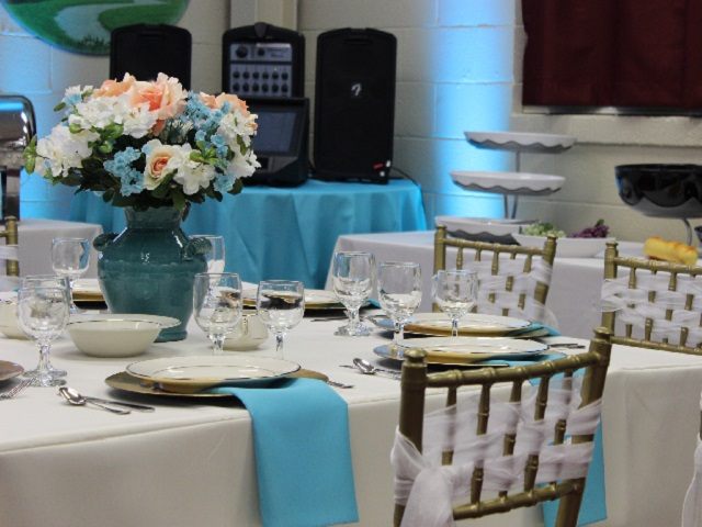 a table with gold chiavari chairs
